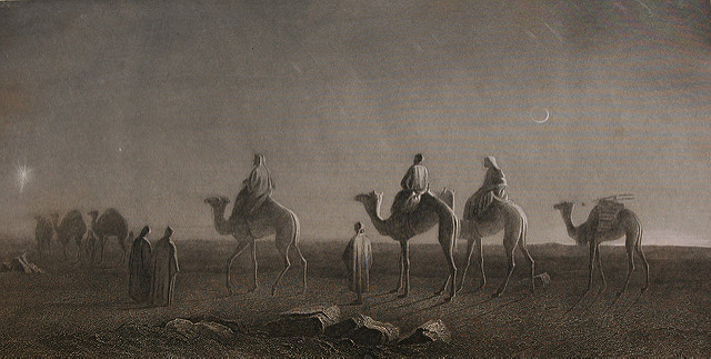Star of Bethlehem, Magi - wise men or wise kings travel on camels with entourage across the deserts to find the savior, moon, desert, Holy Bible, Etching, 1885 (Courtesy of Wonderlane, Flickr Commons http://tinyurl.com/heofx9o(